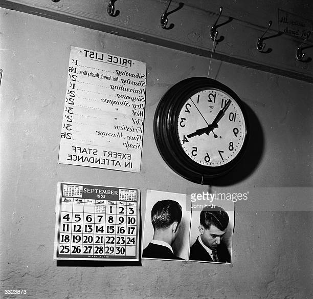A clock and a pricelist inside Joseph Tomassi's barber's shop in London is reversed so that a client facing the mirror can keep a check on the time...