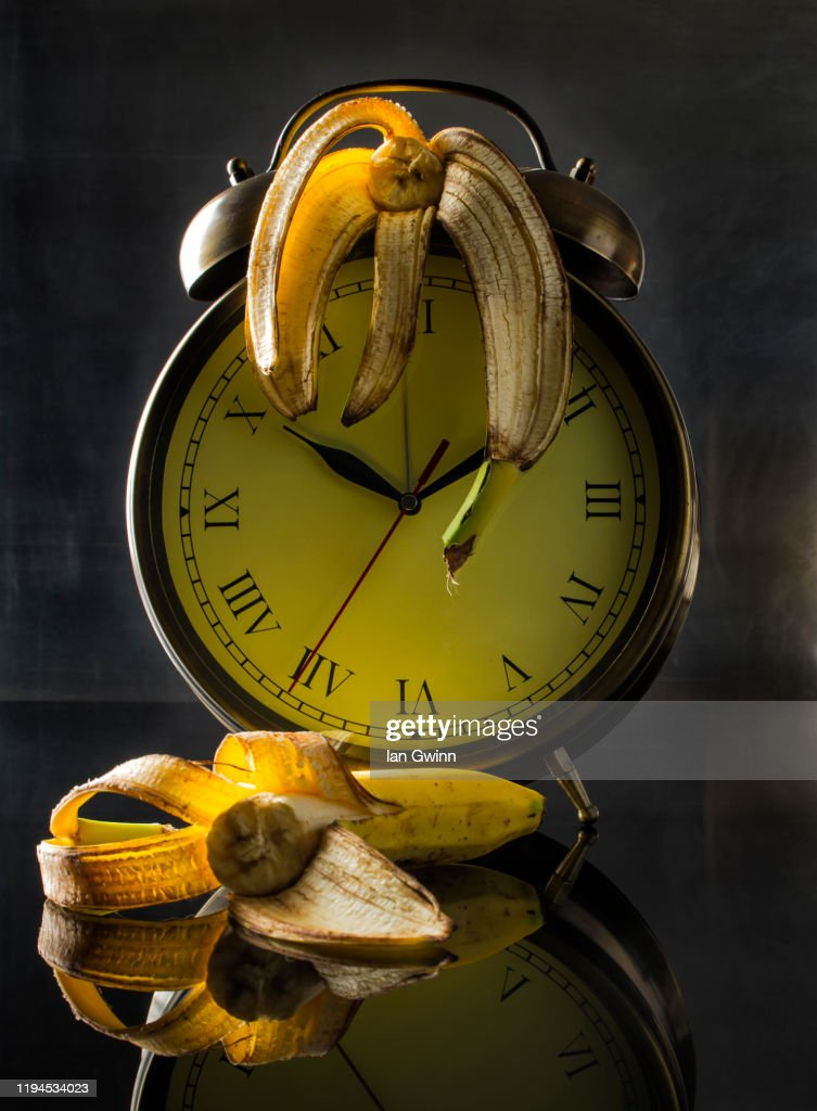 Clock and Bananas : Stock Photo