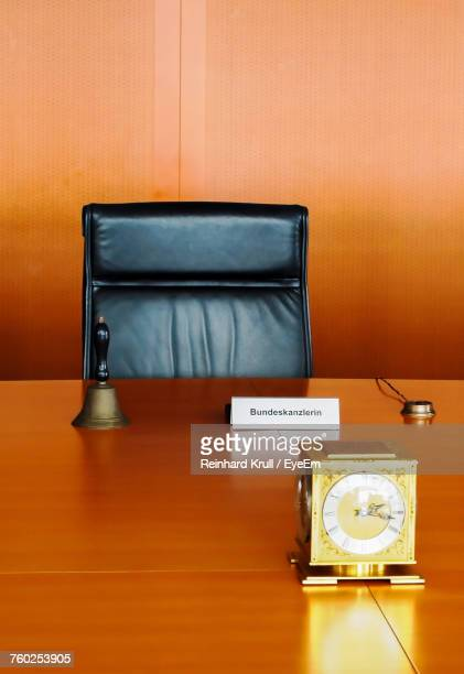 clock and bell with nameplate on table at office - nameplate stock pictures, royalty-free photos & images