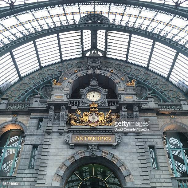 Clock And City Coat Of Arms At Antwerpen Centraal Station