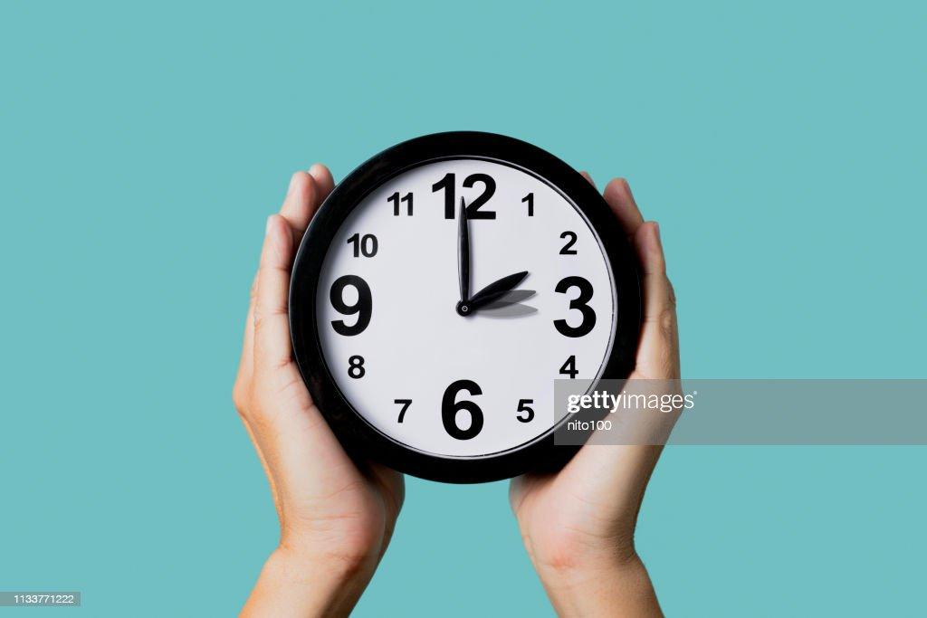 clock being adjusted backward or forward : Stock Photo