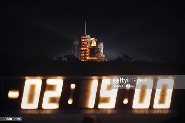 Clock continues to countdown after the launch of the space shuttle Endeavour was called off on June 17, 2009 at the Kennedy Space Center in Florida,...