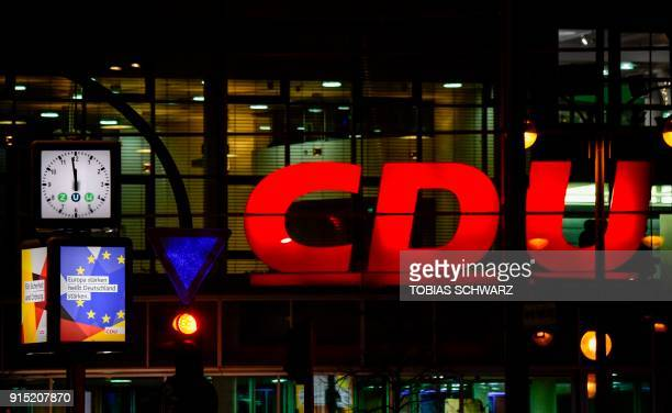 Clock displays almost midnight in front of the Christian Democrats headquarters on February 6, 2018 in Berlin as negotiators from German chancellor's...