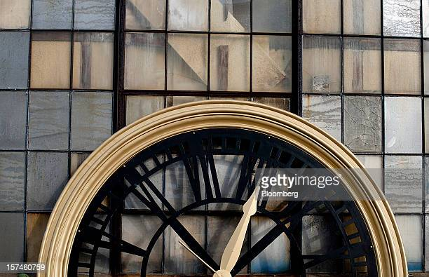 A clock face leans against a wall outside of the Verdin Corp production facility in Cincinnatti Ohio US on Friday Nov 11 2012 The Institute for...