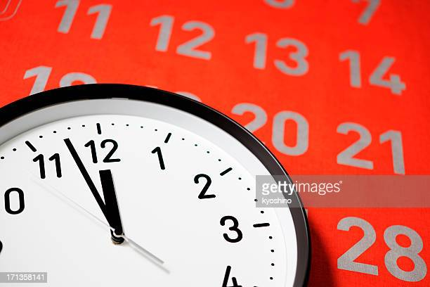 clock face of deadline against large red calendar - countdown clock stock photos and pictures