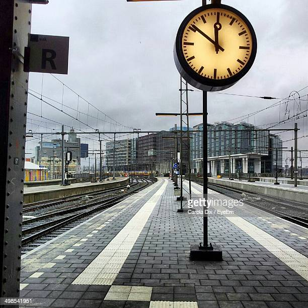 Clock hanging over railroad platform