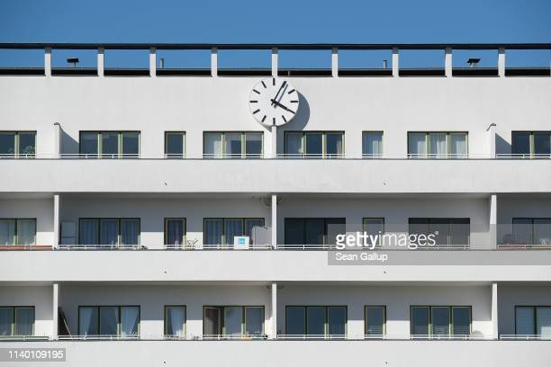A clock hangs over an apartment building of the Weisse Stadt housing estate in Reinickendorf district on April 01 2019 in Berlin Germany The Weisse...