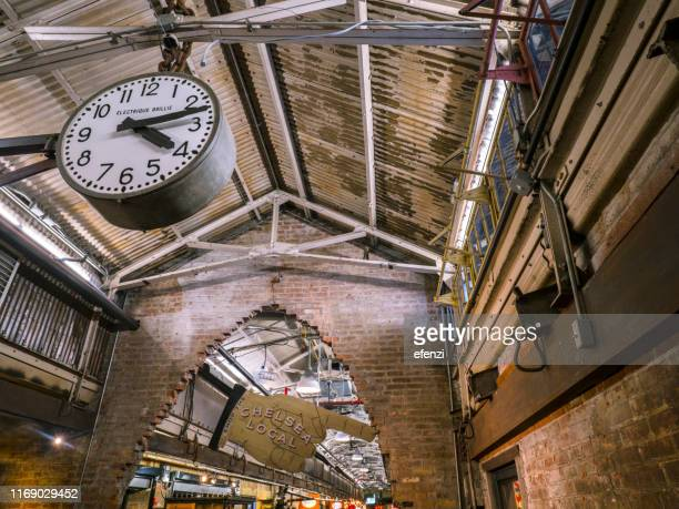 clock in chelsea market - chelsea new york stock photos and pictures