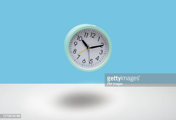 clock in mid air - time stock pictures, royalty-free photos & images