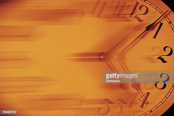 clock in motion - time travel stock pictures, royalty-free photos & images