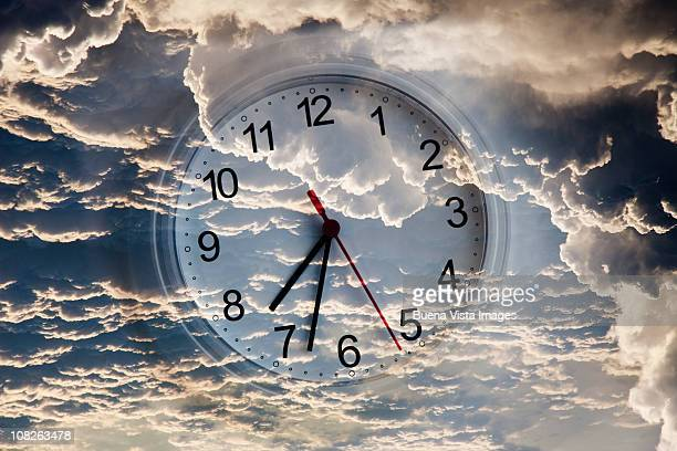Clock in the sky among clouds