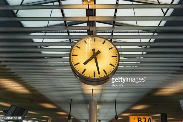 Clock inside airport of Amsterdam