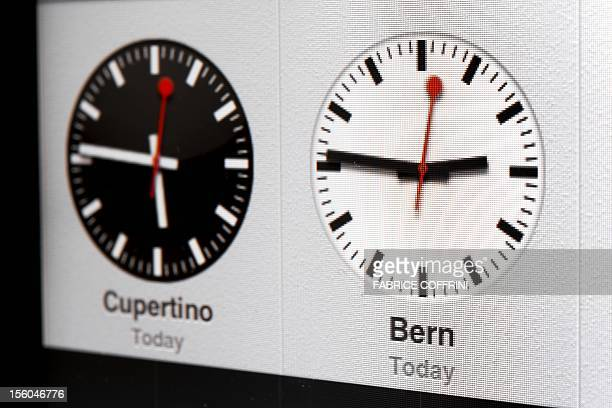 A clock is pictured on a Apple iPad on October 12 2012 in Lausanne US tech giant Apple has dished out 20 million Swiss francs to compensate Swiss...