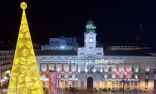 A clock is seen as thousands of people gathered in Sol Square celebrate new year in Madrid Spain January 1 2015