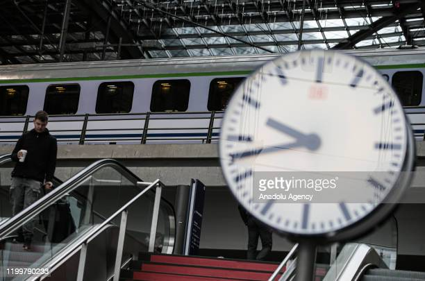 A clock is seen in front of a train at Berlin Central Train Station on February 10 2020 in Berlin Germany within delays due to the forecasted heavy...