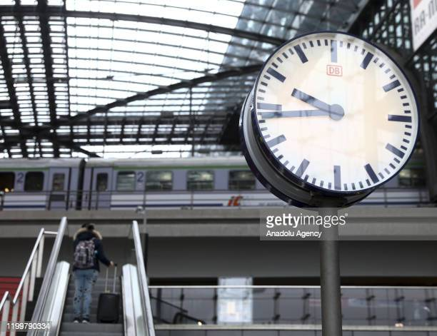 Clock is seen in front of a train at Berlin Central Train Station on February 10, 2020 in Berlin, Germany within delays due to the forecasted heavy...