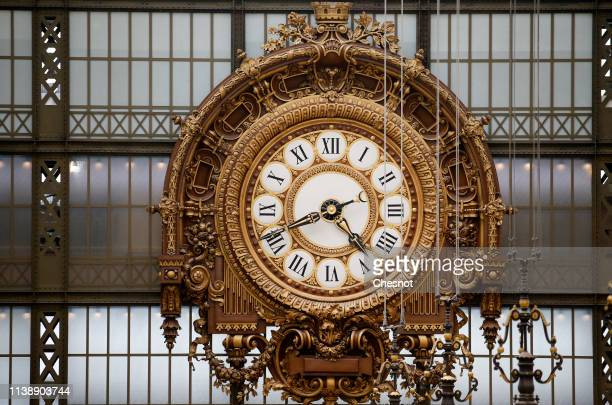 Clock is seen inside the Orsay Museum on March 28, 2019 in Paris, France. The next winter-summer time change will take place on the night of Saturday...
