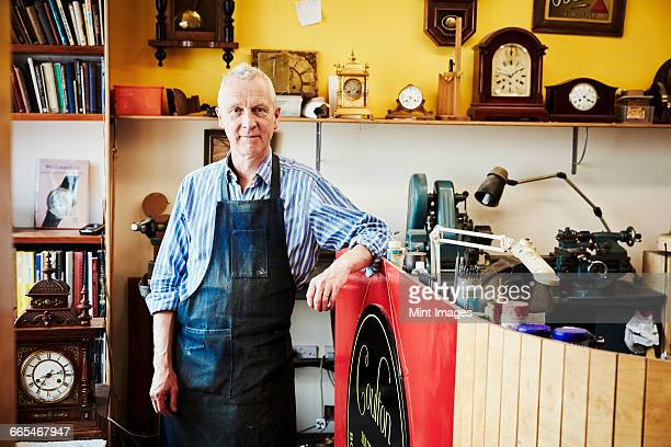 a clock maker in his workshop. - restoring stock pictures, royalty-free photos & images
