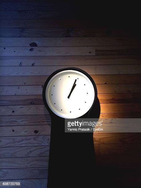 Clock Mounted On Wooden Wall