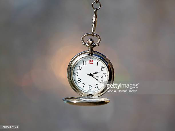 clock of pocket hanging of his chain - pocket chain stock pictures, royalty-free photos & images