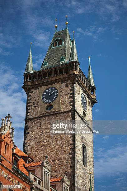 clock on a tower against a blue sky - terence waeland stock pictures, royalty-free photos & images