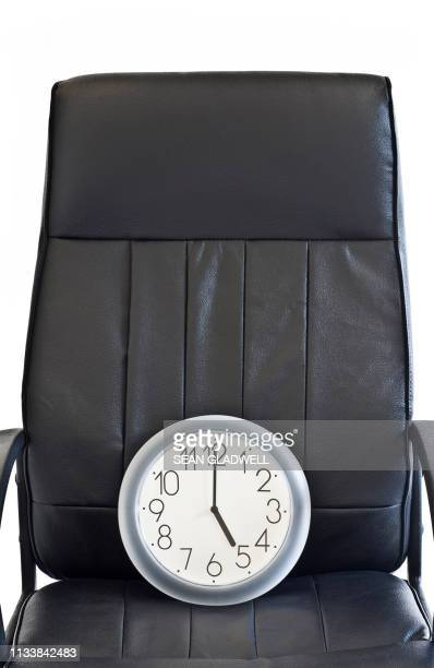 clock on chair at 5 o'clock - clocks go forward stock pictures, royalty-free photos & images