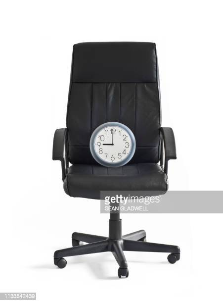 clock on chair at 9 o'clock - clocks go forward stock pictures, royalty-free photos & images