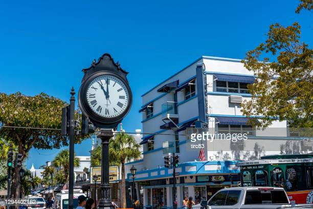 clock on duval street, key west, florida, usa - duval street stock pictures, royalty-free photos & images