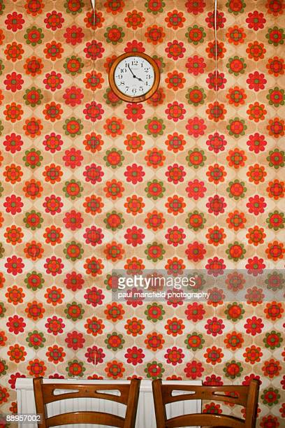 Clock on floral wallpaper