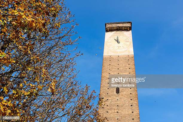 Clock on medieval tower, Pavia, Lombardy, Italy