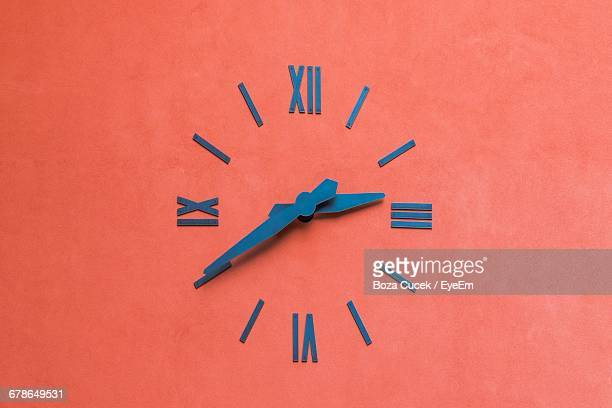 Clock On Orange Wall