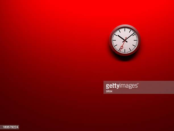 Clock on red wall