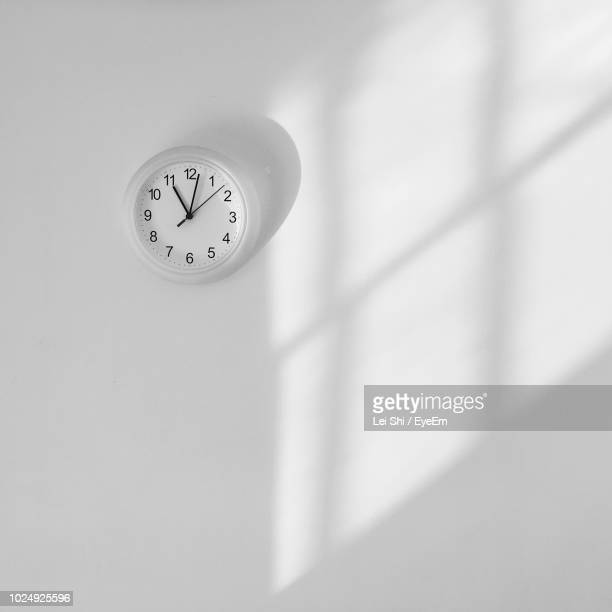 clock on wall at home - wall clock stock photos and pictures