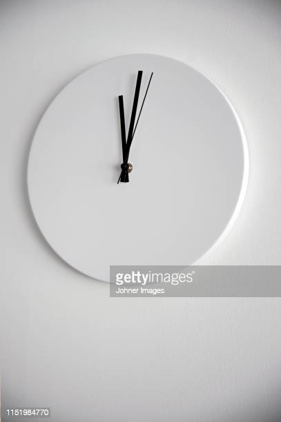 clock on wall - wall clock stock pictures, royalty-free photos & images
