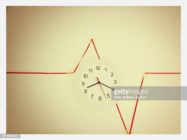 clock on white wall - transfer image stock pictures, royalty-free photos & images