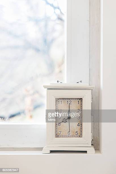Clock on window sill