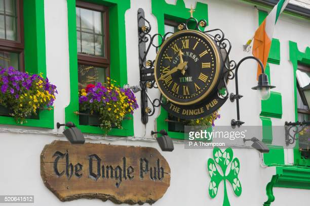 clock outside dingle pub - irish flag stock pictures, royalty-free photos & images