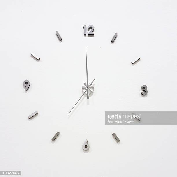 clock over white background - clock face stock pictures, royalty-free photos & images