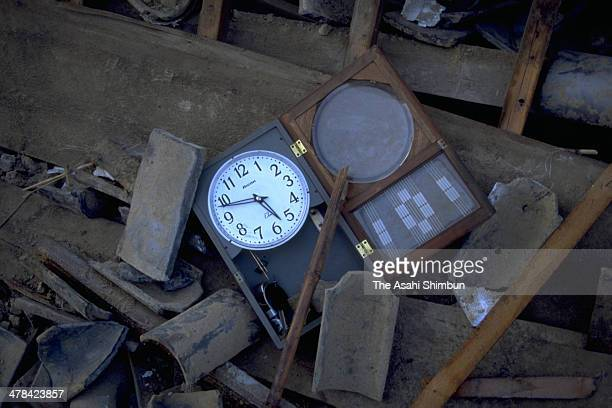 A clock remains stopped at Awajishima Island on Janaury 18 1995 in Hokutan Hyogo Japan Magnitude 73 strong earthquake jolted in the morning of...