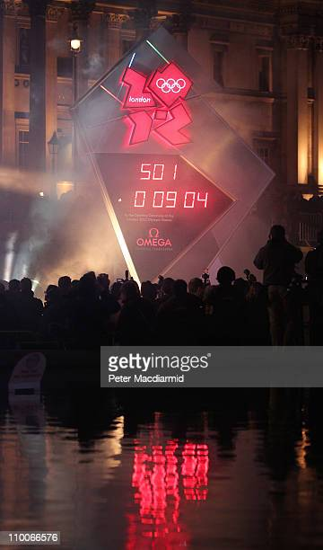 A clock showing a countdown to the start of the London 2012 Olympics is revealed a few minutes before starting on March 14 2011 in London England The...