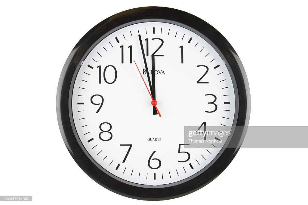 Clock showing two minutes before 12 o'clock : Stock Photo
