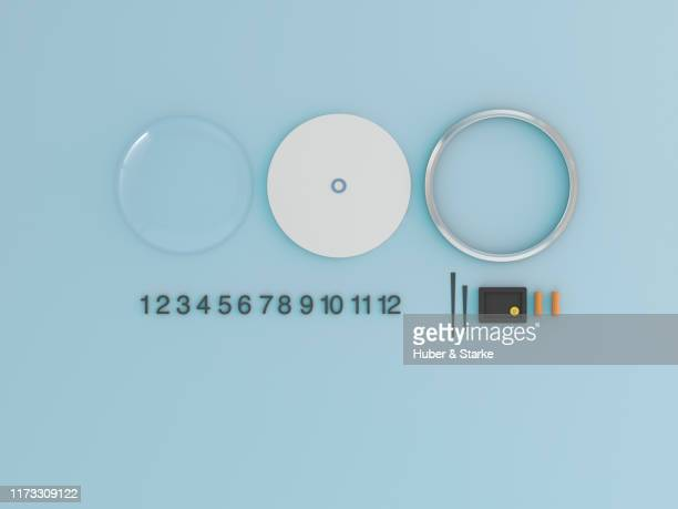 clock shown in component parts - dismantling stock pictures, royalty-free photos & images