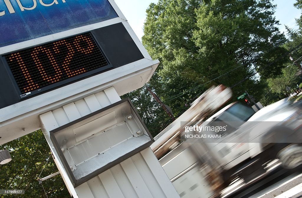 A clock shows a temperature of 102 degre : News Photo