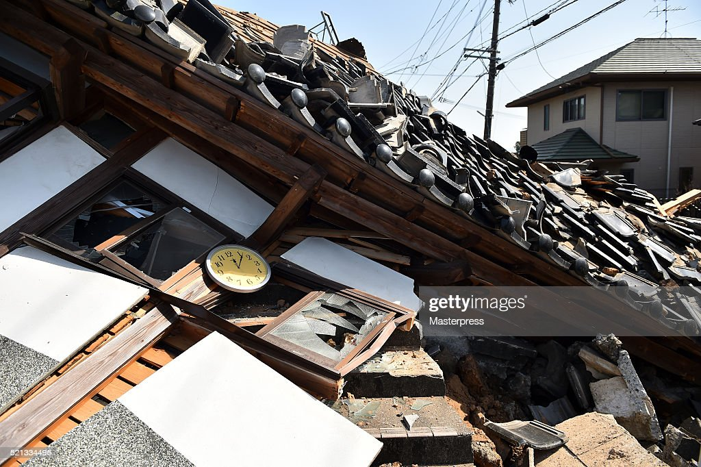 05 is seen in the collapsed house a day after the 2016 Kumamoto Earthquake on April 15, 2016 in Mashiki, Kumamoto, Japan. The owner of the house said that the house was damaged more by the aftershock that happened at 0:05. As of April 15 morning, at least nine people died in the powerful earthquake with a preliminary magnitude of 6.4 that struck Kumamoto Prefecture on April 14, 2016.