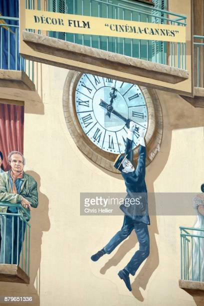 clock stunt from 'safety first' (1923) by harold lloyd. mural wall paintings celebrating movie history, bus station, cannes - cannes stock pictures, royalty-free photos & images