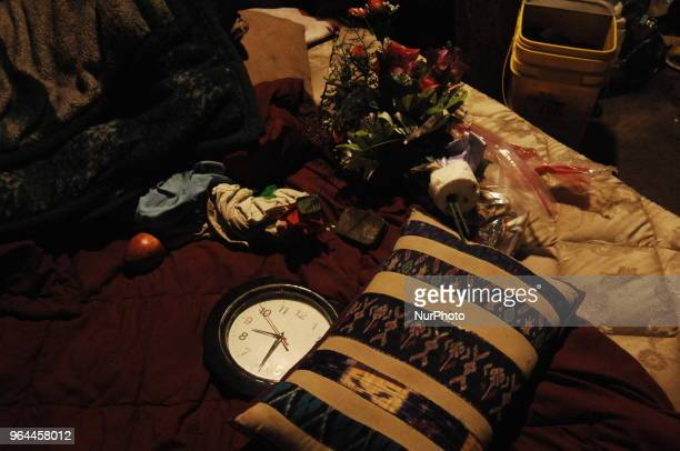 A clock ticks on among items intended to beautify a sleeping area for a couple living at a homeless encampment in the Kensington section of...
