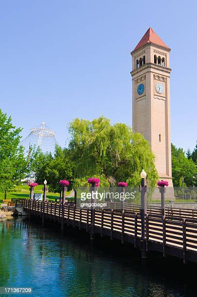 clock tower and bridge at riverfront park in spokane, wa - riverfront park spokane stock photos and pictures