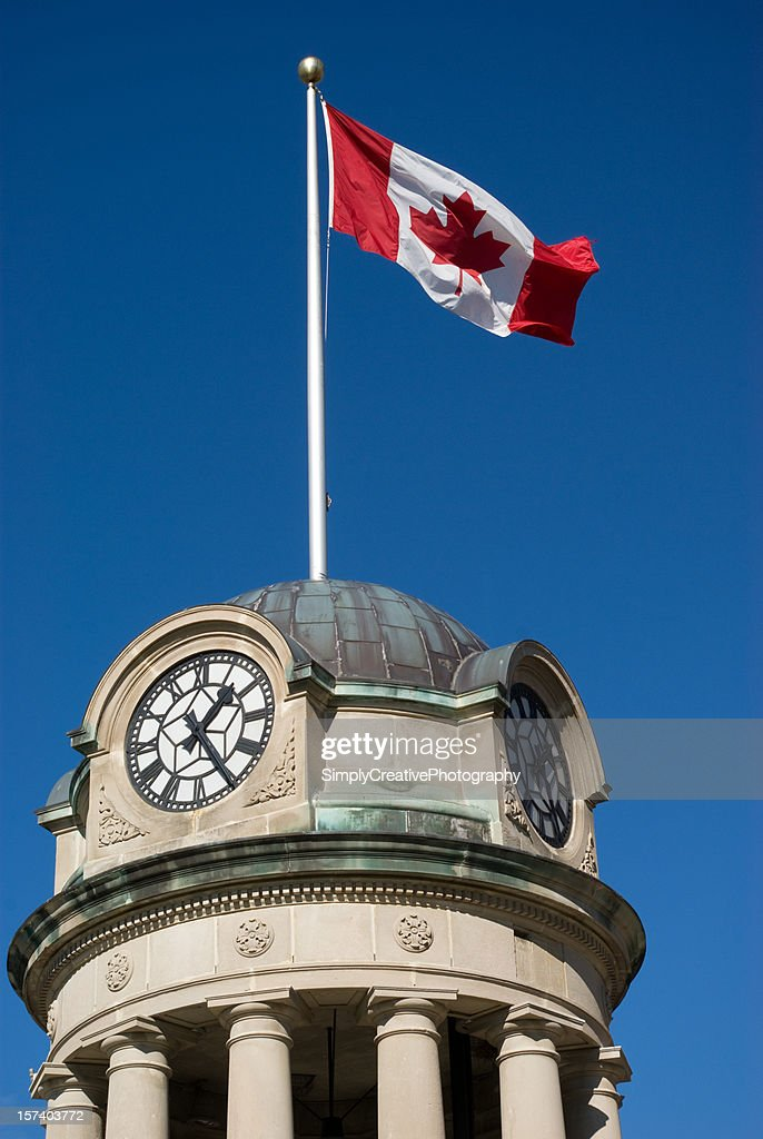 Clock Tower and Flag : Stock Photo
