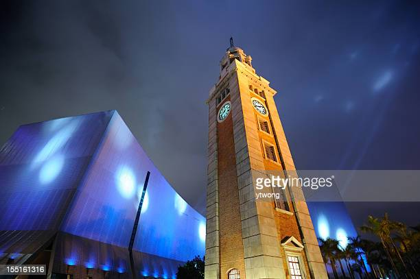 clock tower and hong kong cultural center - clock tower stock pictures, royalty-free photos & images