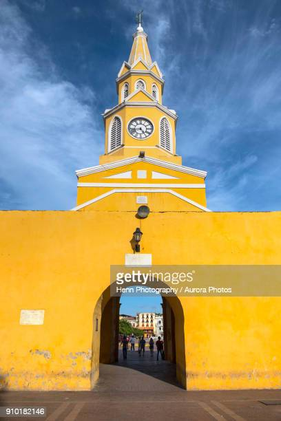 clock tower (torre del reloj) and main gate of old city wall in cartagena, bolivar, colombia - cartagena colombia stock pictures, royalty-free photos & images